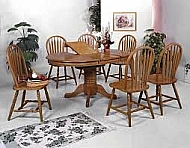 OAK PEDESTAL TABLE AND 4 CHAIRS